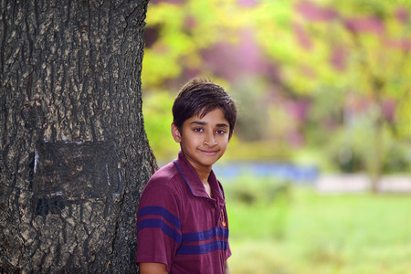 Handsome Indian toddler standing outdoor smiling Stock Photo - 24293060