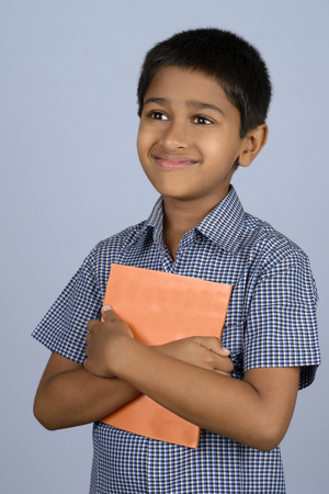 Handsome Indian toddler ready to go to school photo