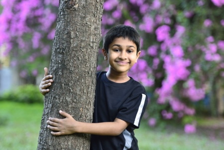 Handsome Indian toddler standing outdoor smiling photo