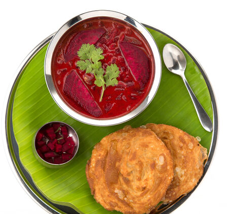 chaat: Fried Dough with Beetroot chutney served authentically Stock Photo