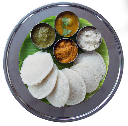 Idli and sambar isolated on white background.  South Indian Snack photo