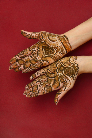 mogul: beautifully decorated indian hands with mehandi typically done for weddings