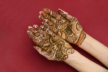 beautifully decorated indian hands with mehandi typically done for weddings photo