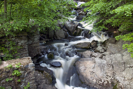 Water flowing through Southford falls in Spring, photo