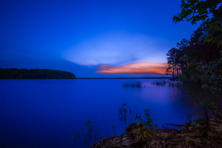 cary: gorgeous sun setting at a local lake Stock Photo