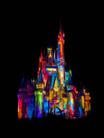 Disney castle beautifully lit with colors Stock Photo