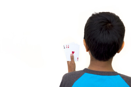 Child holding poker cards on a white background Imagens
