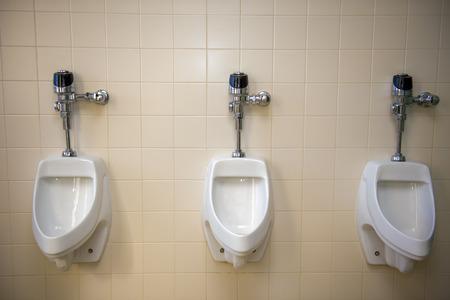 A set of urinals in a restroom