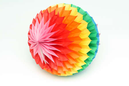 Bright childrens toy - a colour paper sphere photo