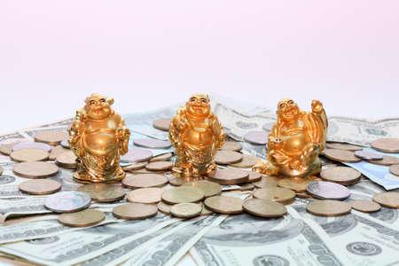 Buddha netsuke and money photo