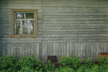 hobnail: retro wooden house with window and flowers background