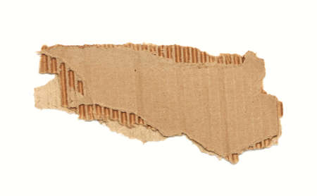 torn edge: Piece of corrugated cardboard with torn edge. Isolated on white. Stock Photo