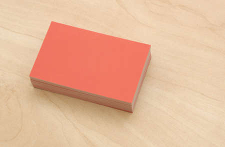 stack of business cards: block of business cards on a wooden table Stock Photo