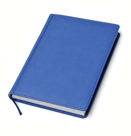 isolated blue notebook on white photo