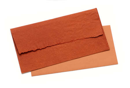 orange envelope by hand on a white background photo
