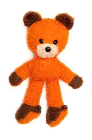 old orange bear toy isolated on white photo