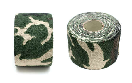 Roll of fabric camouflage tape on a white background photo