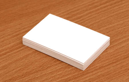 Blank business cards stacked up on a desk Stock Photo - 9991810