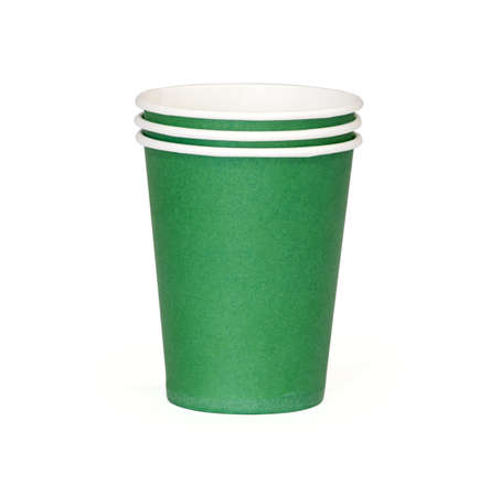 Green disposable cup isolated on a white background photo