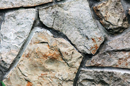 Colorful and textured stone masonry wall useful for backgrounds photo