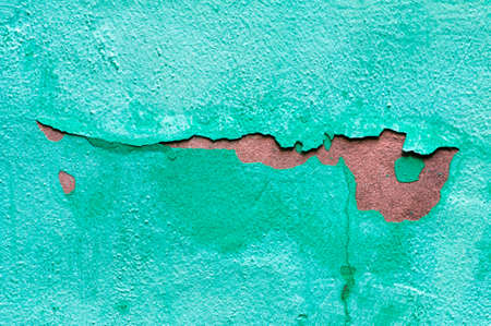 old paint and wall, cracked wall color blue photo