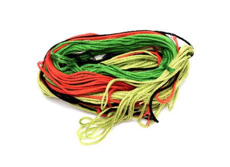 needlecraft: ball of multi-colored needlecraft thread isolated on white