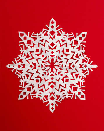 beautiful snowflake on a red background photo