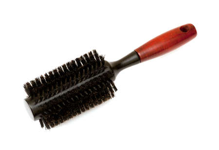 Hair brush isolated on a white background Фото со стока