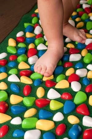 Orthopedic rug for children Stock Photo