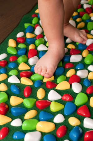 Orthopedic rug for children Stock Photo