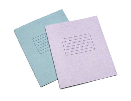 multicolored exercise books over the white background photo