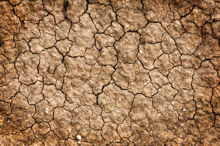 red clay: Dry red clay soil texture, natural floor background