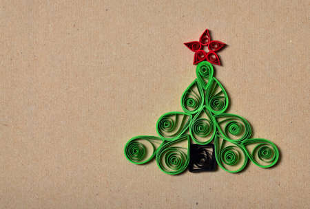 Handmade Christmas tree cut out from paper  Quilling  photo