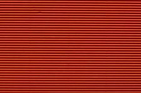 Texture of red corrugated paper for background used photo