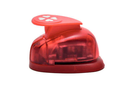 paper puncher: Red paper puncher on a white isolated background