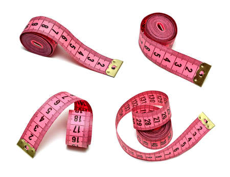 Pink measuring tape isolated on white photo