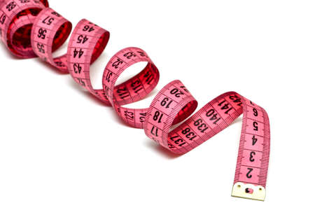 Pink measure tape on white background photo