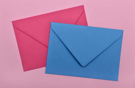 two envelopes on a pink background photo