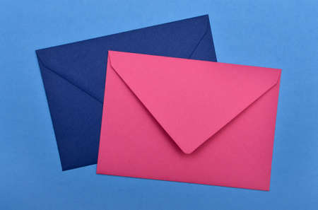 two envelopes on a blue background Stock Photo - 17299460