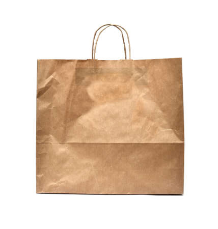 carryall: Front of brown crumpled paper bag form the market