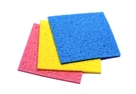 spring cleaning: colorful sponge on white background Stock Photo