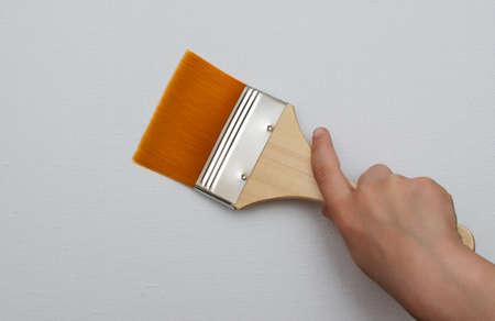 Hand holds brush isolated on white background photo