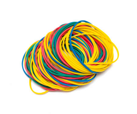 Colorful rubber bands on white background photo