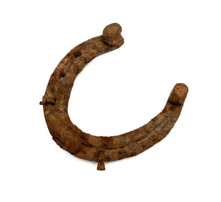 old rusty horseshoe isolated on white background photo