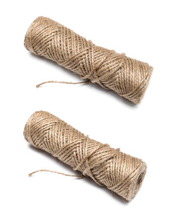 bobbin of the natural country thread isolated on white background photo