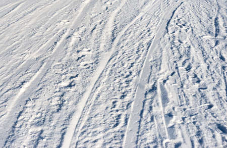 snowbanks: Closeup photo of skis marks on snow slope Stock Photo