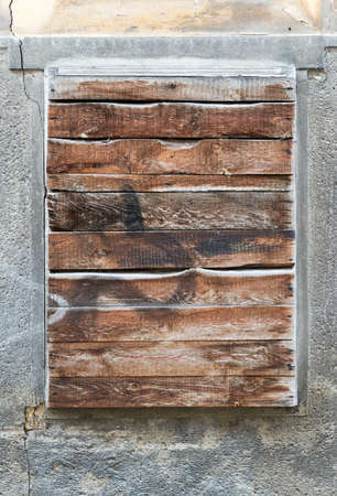 boarded up: A old exterior brick wall with an old boarded up window ready for your content Stock Photo