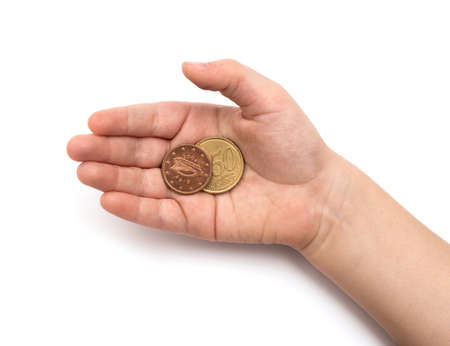 thrifty: Coins in childs hand on white background