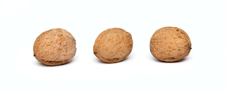 circassian: three walnuts close up isolated on white background