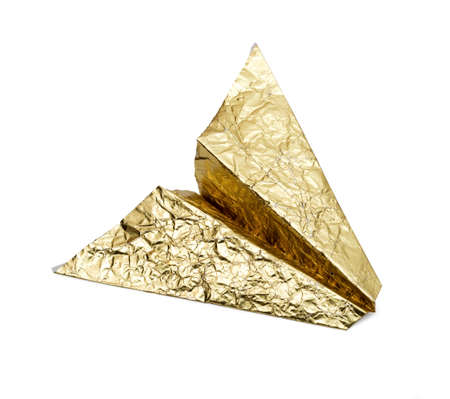 origami paper: Plane of gold foil on a white background